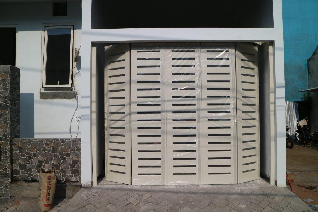 rel pintu garasi malang